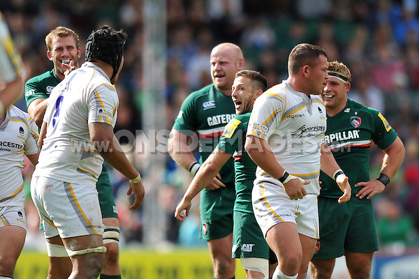 David Mele taunts Worcester Warriors' number 8 Semisi Taulava after a big scrum. Aviva Premiership match, between Leicester Tigers and Worcester Warriors on September 8, 2013 at Welford Road in Leicester, England. Photo by: Patrick Khachfe / JMP