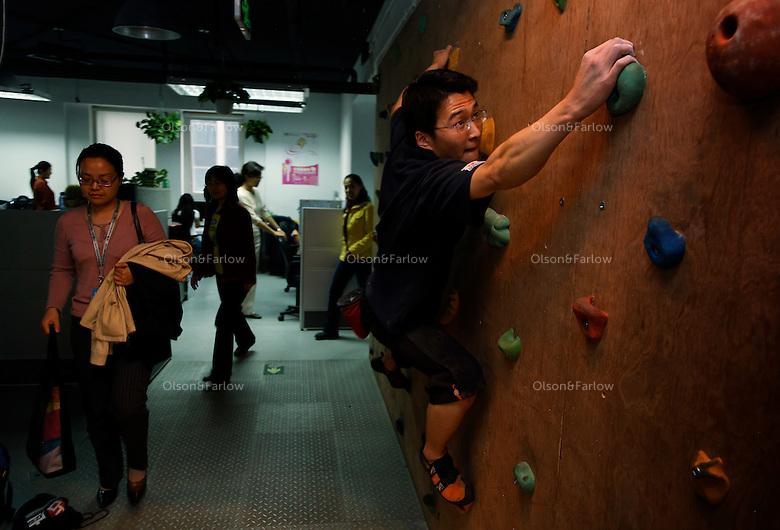 www.eyou.com offices.  They have a climbing wall... the CEO's computer used to found the company is embedded in one of the walls... equations are worked out on the glass walls of the managers offices. The guy on the climbing wall is Ruan Guowei, nuangw@eyou.net  +86 135 0117 6129.Contacts for the company are: CEO Jack Zhou+86 139 1066 6168  and PR manager Luo Peng +86 139 1041 1230 luopeng@zhanzuo.net.Contact is Evelyn +86 137 1896 4824