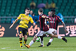 AC Milan Midfielder Franck Kessie (R) fights for the ball with Borussia Dortmund Midfielder Christian Pulisic (L) during the International Champions Cup 2017 match between AC Milan vs Borussia Dortmund at University Town Sports Centre Stadium on July 18, 2017 in Guangzhou, China. Photo by Marcio Rodrigo Machado / Power Sport Images
