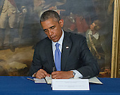 "United States President Barack Obama signs a book of condolence to honor those killed in the terrorist attack on the offices of Charlie Hebdo magazine in Paris, France yesterday at the Embassy of France in Washington, D.C. on Thursday, January 8, 2014.  The President's inscription reads ""On behalf of all Americans, I extend our deepest sympathy and solidarity to the people of France following the terrible terrorist attack in Paris.  As allies across the centuries, we stand united with our French brothers to ensure that justice is done and our way of life is defended.  We go forward together knowing that terror is no match for freedom and ideals we stand for - ideals that light the world.<br /> Vive la France!""<br /> Credit: Ron Sachs / Pool via CNP"