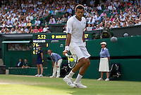 Jo-Wilfred Tsonga (FRA) (10) against  Andy Murray (GBR) (4) in the Quarter Finals of the gentlemen's singles. Andy Murray beat Jo-Wilfred Tsonga 6-7 7-6 6-2 6-2 ..Tennis - Wimbledon Lawn Tennis Championships - Day 9 Wed 30 Jun 2010 -  All England Lawn Tennis and Croquet Club - Wimbledon - London - England..© FREY - AMN IMAGES  Level 1, Barry House, 20-22 Worple Road, London, SW19 4DH.TEL - +44 (0) 20 8947 0100.Email - mfrey@advantagemedianet.com.www.advantagemedianet.com