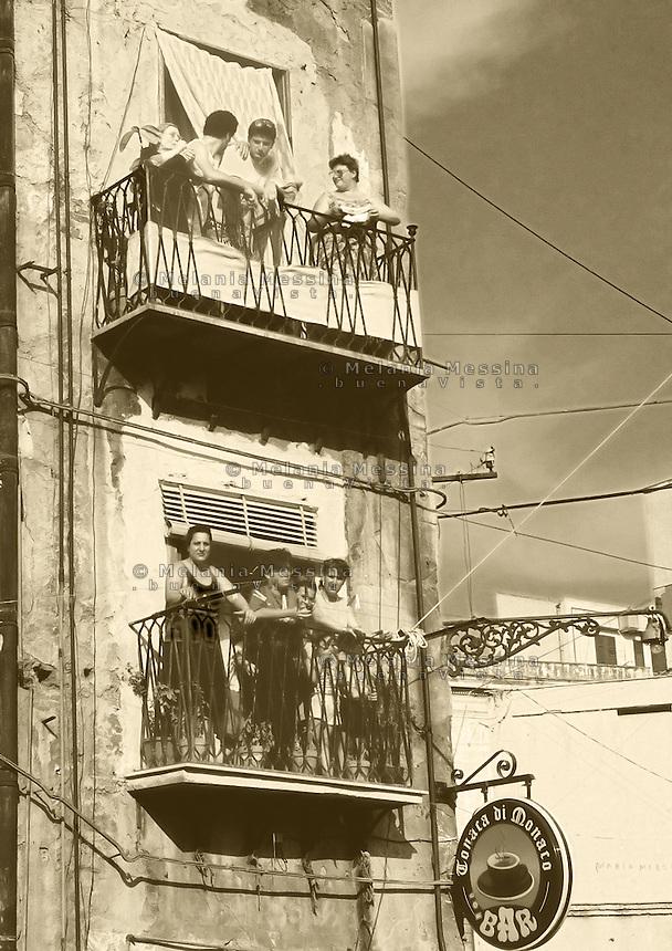 Historic city center Palermo, balconies in Ballaro' market district.<br /> Centro storico di Palermo, quartiere del mercato Ballaro'