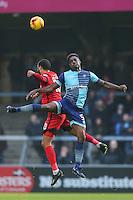 Paul McCallum of Leyton Orient (10) and Anthony Stewart of Wycombe Wanderers in an aerial battle during the Sky Bet League 2 match between Wycombe Wanderers and Leyton Orient at Adams Park, High Wycombe, England on 17 December 2016. Photo by David Horn / PRiME Media Images.