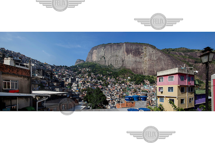 The cliff face of Dois Irmaos (Two Brothers Mountain) rises behind the Rocinha favela.