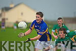 Declan Doody of the Green with the ball as Enda O'Sullivan tries to  stop him from advancing with the ball in the O'Sullivan Cup at Pat Healy Memorial Park,  on Wednesday