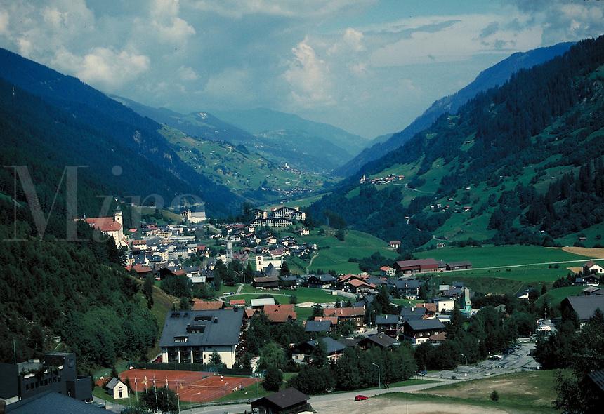 Aerial view of village nestled in valley. Bellizonia Italian Alps Switzerland Europe.