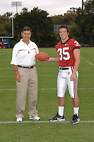 7 August 2006: Stanford Cardinal head coach Walt Harris and Blaise Johnson during Stanford Football's Team Photo Day at Stanford Football's Practice Field in Stanford, CA.