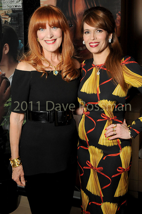 Gracie Cavnar and Karina Barbieri at the Recipe for Success' Delicious Alchemy Dinner at the home of Becca Cason Thrash Wednesday April 19,2017.(Dave Rossman Photo)