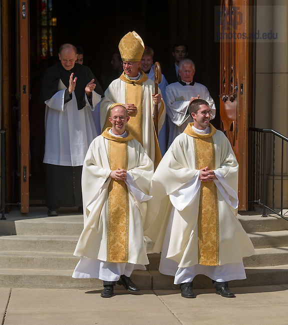 Apr. 26, 2014; Rev. Adam Booth, C.S.C., left, and Rev. Patrick Reidy, C.S.C. leave the Basilica of the Sacred Heart after their Ordination.<br /> <br /> Photo by Matt Cashore/University of Notre Dame