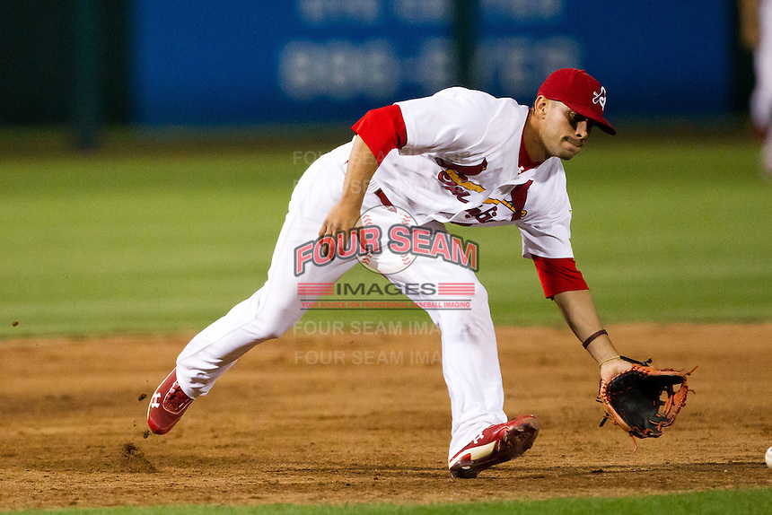 Jose Garcia (3) of the Springfield Cardinals fields a ground ball during a game against the Arkansas Travelers at Hammons Field on June 13, 2012 in Springfield, Missouri. (David Welker/Four Seam Images)