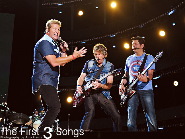 Gary LeVox, Joe Don Rooney, and Jay DeMarcus of Racal Flatts perform at LP Field during the 2012 CMA Music Festival on June 10, 2011 in Nashville, Tennessee.