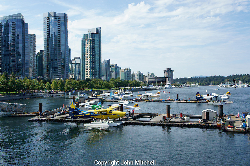 Floatplanes or seaplanes docked at the Vancouver Harbour Water Airport in Coal Harbour, Vancouver, BC, Canada