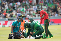 Safaraz Ahmed (Pakistan) receives treatment following a blow during Pakistan vs Bangladesh, ICC World Cup Cricket at Lord's Cricket Ground on 5th July 2019