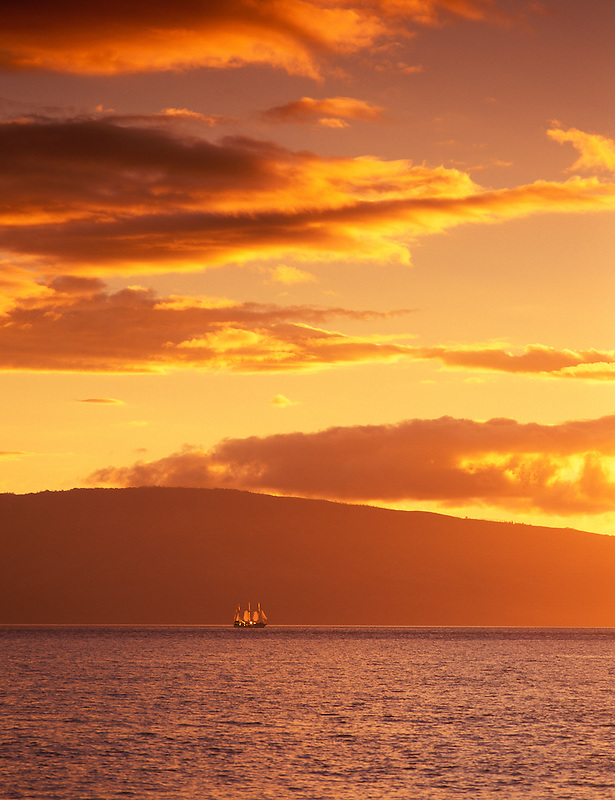 F00135M.tiff   Backlit old time sailing ship at sunset. Island of Lanai in back. Shot from Maui, Hawaii