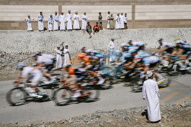 The peloton pass by during Stage 5 of the 10th Tour of Oman 2019, running 152km from Samayil to Jabal Al Akhdhar (Green Mountain), Oman. 20th February 2019.<br /> Picture: ASO/P. Ballet | Cyclefile<br /> All photos usage must carry mandatory copyright credit (© Cyclefile | ASO/P. Ballet)