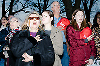 People stand during the National Anthem before the Make America Great Again! Welcome Celebration honoring soon-to-be president Donald Trump at the Lincoln Memorial in  Washington, D.C., on Thurs., Jan. 19, 2017, the day before the presidential inauguration of Donald Trump. The event had musical performances, speeches, and an appearance by Trump and his family.