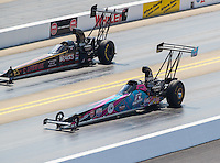 Sep 16, 2016; Concord, NC, USA; NHRA top alcohol dragster driver Megan Meyer (near) races alongside Mike Lewis during qualifying for the Carolina Nationals at zMax Dragway. Mandatory Credit: Mark J. Rebilas-USA TODAY Sports