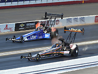 Nov 10, 2018; Pomona, CA, USA; NHRA top fuel driver Mike Salinas (near) alongside Bill Litton during the Auto Club Finals at Auto Club Raceway. Mandatory Credit: Mark J. Rebilas-USA TODAY Sports