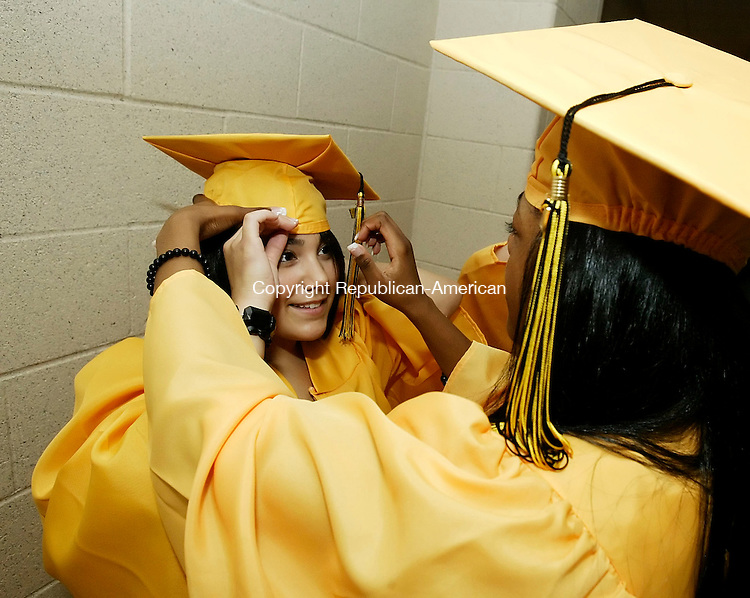 WATERBURY, CT 6/19/07- 061907BZ07-  Raqual Rosario (CQ), of Waterbury, gets help with her mortarboard from Kiara Parker, of Waterbury;  before Warren Fox Kaynor Technical High School commencement excercises at the Palace Theater Tuesday. <br /> Jamison C. Bazinet Republican-American