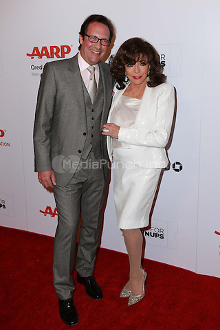 BEVERLY HILLS, CA - FEBRUARY 2: Percy Gibson, Joan Collins at the AARP 14th Annual Movies For Grownups Awards Gala at the Beverly Wilshire Hotel in Beverly Hills, CA on February 2, 2015. Credit: David Edwards/DailyCeleb/MediaPunch