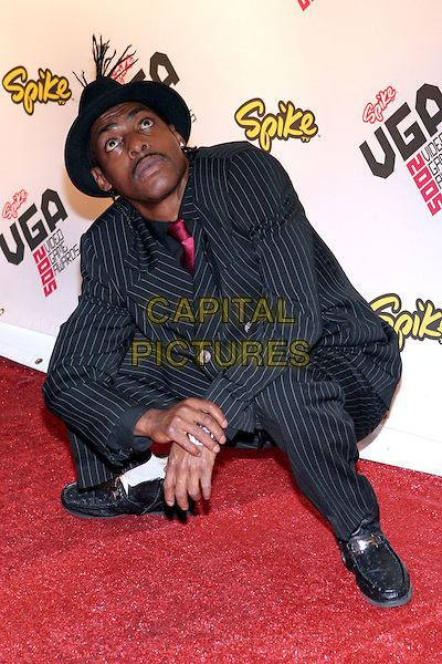 COOLIO.2005 Spike TV Video Game Awards - Arrivals held at the Gibson Amphitheater, Universal City, California..November 18th, 2005.Photo: Zach Lipp/AdMedia/Capital Pictures.Ref: Zl/ADM.full length kneeling crouching hat black pinstripe suit gesture.www.capitalpictures.com.sales@capitalpictures.com.© Capital Pictures.