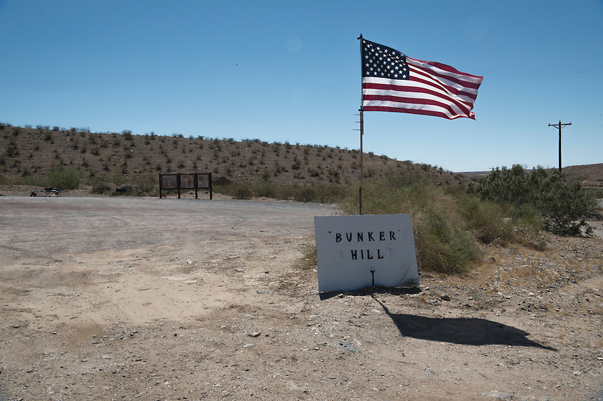 American flag waves in front of the camp of Cliven Bundy's supporters, near the Cliven Bundy ranch in Bunkerville, Nevada.<br /> <br /> Supporters of Bundy came from all over the country to defend against what they believe is government overreach.<br /> The Bundy standoff is a 20-year legal dispute between the United States Bureau of Land Management (BLM) and cattle rancher Cliven Bundy, over unpaid grazing fees, that recently provoked an armed confrontation between protesters and law enforcement.