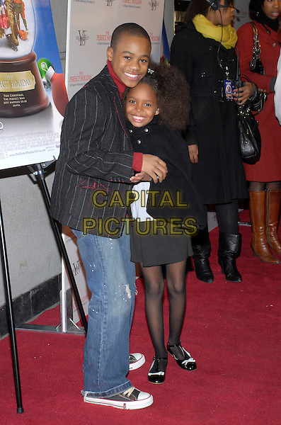 """MALIK HAMMOND & KHAIL BRYANT.The stars come out to party and celebrate """"The Perfect Holiday""""  at Marquee, New York, New York, USA,.10 December 2007..full length .CAP/ADM/BL.©Bill Lyons/AdMedia/Capital Pictures. *** Local Caption ***"""