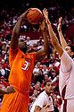 12 February 2011: Oklahoma State Cowboys center Jarred Shaw #1 puts a shot with Nebraska Cornhuskers center Jorge Brian Diaz #21 trying to block during the second half at the Devaney Sports Center in Lincoln, Nebraska. Nebraska defeated Oklahoma State 65 to 54.