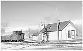 D&amp;RGW northbound freight passing Moffat depot, built in 1941.<br /> D&amp;RGW  Moffat, CO  Taken by Richardson, Robert W. - 11/1950