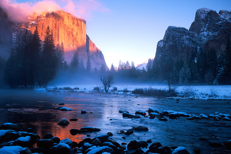 The warm colors of sunset on El Capitan warms up an otherwise cold snowy valley in Yosemite