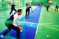 New Zealand Men Captain Mark Cini advances down the pitch and is bowled, vs England.<br /> 2003 Indoor Cricket World Masters Championships, Christchurch, New Zealand