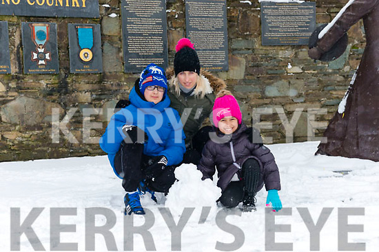 Kieran Shamsuddona, Kaylin Shamsuddona and Klarika Roosipuu from Killarney enjoying the snow last Friday.