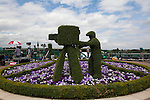 Mcc0032212 .Daily Telegraph..A topiary hedge of a cameraman on the roof of the broadcasting centre..The first day of The Lawn Tennis Championships at Wimbledon..20 June 2011 Wimbledon