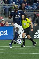 Foxborough, Massachusetts - April 28, 2018:  The New England Revolution (blue) beat Sporting Kansas City (light blue) 1-0 in a Major League Soccer (MLS) match at Gillette Stadium.