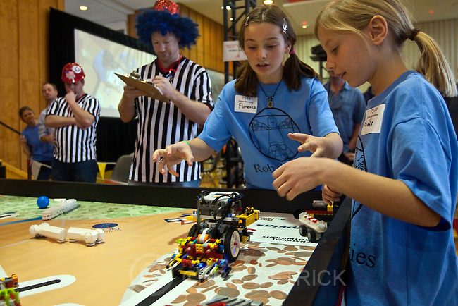 Chris Detrick  |  The Salt Lake Tribune .Robo Newbies' Florence Thirlwell, left, Maddie Vandel, watch as the team robot competes during the Utah First Lego League Championship at the University of Utah Saturday January 29, 2011. Fifty-six junior-high-aged teams, 560 total kids, from across the state competed in contests using Lego robots they built.