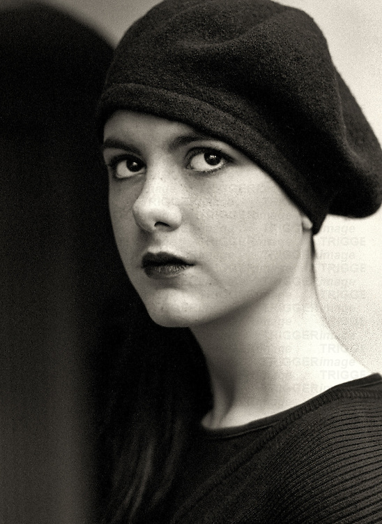 A young woman wearing a dark beret