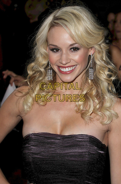 "TYNE STECKLEIN .""Burlesque"" Los Angeles Premiere held at Grauman's Chinese Theatre,Hollywood, California, USA, .15th November 2010..headshot portrait strapless smiling cleavage purple black tulle .CAP/ADM/CH.©Charles Harris/AdMedia/Capital Pictures"