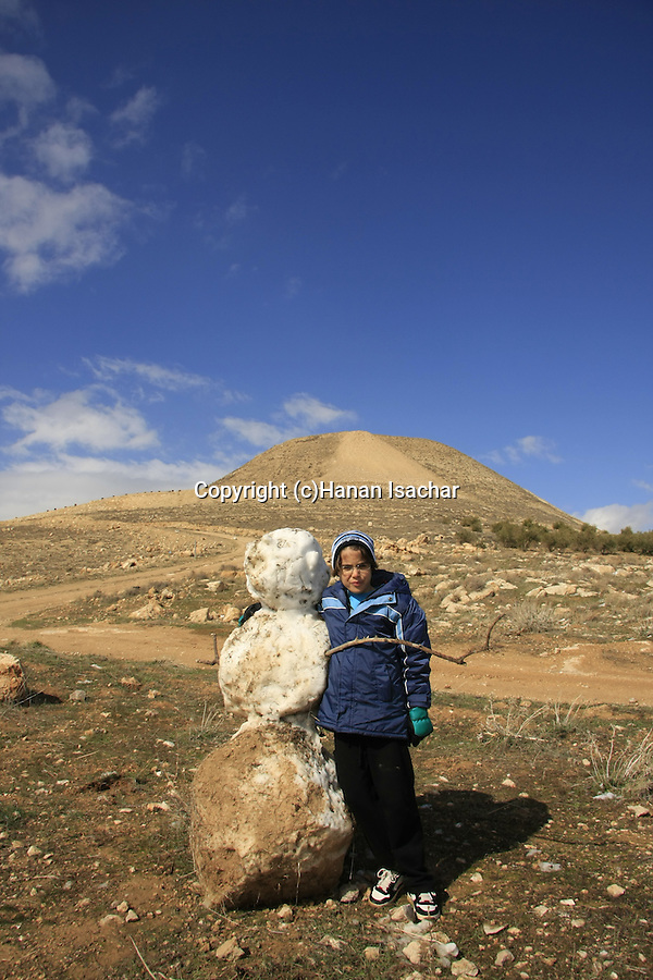 Judea, Noam Isachar with a snowman by Mount Herodion
