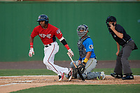 Potomac Nationals Osvaldo Abreu (5) at bat in front of catcher Miguel Amaya and umpire Josh Gilreath during a Carolina League game against the Myrtle Beach Pelicans on August 14, 2019 at Northwest Federal Field at Pfitzner Stadium in Woodbridge, Virginia.  Potomac defeated Myrtle Beach 7-0.  (Mike Janes/Four Seam Images)