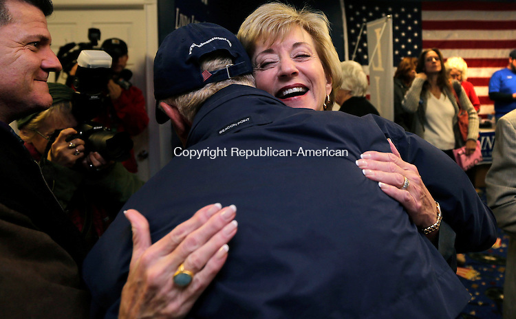 Republican candidate for U.S. Senate Linda McMahon embraces volunteer Bruce Farmer, of Clinton, Conn., while visiting a campaign office in East Lyme, Conn., Monday, Nov. 5, 2012. McMahon and Democratic opponent Chris Murphy are vying for the Senate seat now held by Joe Lieberman, an independent who's retiring. (AP Photo/Charles Krupa)