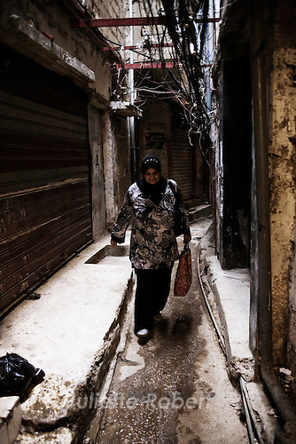 Linda Yussef, midwife at the Haifa Hospital of the palestinian camp of Burj el Barajneh, walks early morning in the camp alleys.<br /> <br /> Linda Yussef, sage-femme &agrave; l'h&ocirc;pital Haifa du camp palestinien de Burj el Barajneh, dans les ruelles du camp au petit matin