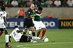 1 March 2006: Ghana's Sulley Muntari (11) tackles the ball away from Mexico's Pavel Pardo (8). The National Team of Mexico defeated the National Team of Ghana 1-0 at Pizza Hut Park in Frisco, Texas in an International Friendly soccer match.