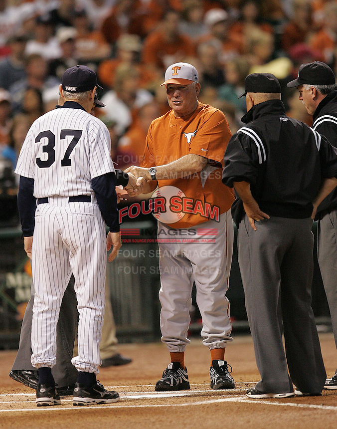 Texas Longhorns Manager Augie Garrido meets with Rice Manager Wayne Graham (37) during the 2008 season. Photo by Andrew Woolley / Four Seam Images.