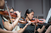The Occidental Symphony Orchestra during rehearsal and also a performance in Thorne Hall on October 10, 2019.<br /> The Occidental Symphony Orchestra, comprised of approximately 60 musicians, is dedicated to performing symphonic repertoire from the baroque through the twentieth century, as well as contemporary works of our time. The Symphony Orchestra is directed by Chris Younghoon Kim and presents 4 to 6 concerts per year. The orchestra has collaborated with many of today's most prominent composers including Forrest Pierce.<br /> (Photo by Marc Campos, Occidental College Photographer)