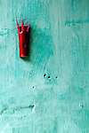 Incense 04 - Red incense stick holder on a blue wall in Nguyen Thai Hoc St, Hoi An, Viet Nam