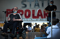 """Dino (Disabled Person Worker).<br /> <br /> Rome, 05/07/2020. Today, thousands of people gathered in Piazza San Giovanni to attend the """"Stati Popolari"""". The rally, organised by Aboubakar Soumahoro (1.) - Trade Union Coordinator of the Unione Sindacale di Base USB, was meant to be a popular answer by the """"Invisibles"""" to the """"Stati Generali dell'Economia"""" (States General of the Economy, 2.) of the Italian Prime Minister Giuseppe Conte, a 10-day-long meeting held in June at Villa Doria Pamphili (Villa Doria Pamphilj, 2.) where Italian and EU leaders / members of Governments, bankers, investors, advisors, met to discuss the economic recovery from the Covid-19 / Coronavirus crisis. From the organisers Facebook event page: «The Popular States will be our agora, where different realities will bring their pains and their proposals. A human square to make all the invisible visible and to give voice to all the unheard, our only symbol. The Popular States will be the communion of our needs and our struggles […]» (3.). At the end of the demo Soumahoro, who mainly deals with protection of """"Braccianti"""" (agricultural workers) rights, fights against """"caporalato"""" (illegal hiring) and the exploitation along the agricultural supply chain, gave a speech (4.) addressing the requests to the Government: - National plan for the work emergency; - Public housing program; - integral reform of the food supply chain; - radical transformation of migration policies (including, the """"right to return"""" for Italian migrants); - abolish the """"Security decrees"""" and cancel Bossi-Fini law; - reform the reception; - ecological transition strategy; - proactive interventions against discrimination and for equality.<br /> <br /> Footnotes & Links:<br /> 1. (Wikipedia.org) http://bit.do/fF4rH<br /> 2. 16.06.20 Aboubakar Soumahoro: Hunger/Thirst Strike And Meeting With Italian Prime Minister Conte http://bit.do/fGrbH<br /> 3. http://bit.do/fGrbD & https://www.facebook.com/StatiPopolari/<br /> 4. Aboubakar Soumah"""