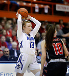 February 28, 2020; Yankton at St. Thomas More High School Basketball -- Haleigh Timmer #13 of St. Thomas More looks past Yankton defender Payton Wolfgram #10 during their game Friday evening at Barnett Arena in Rapid City, S.D.(Photo by Richard Carlson/Inertia)