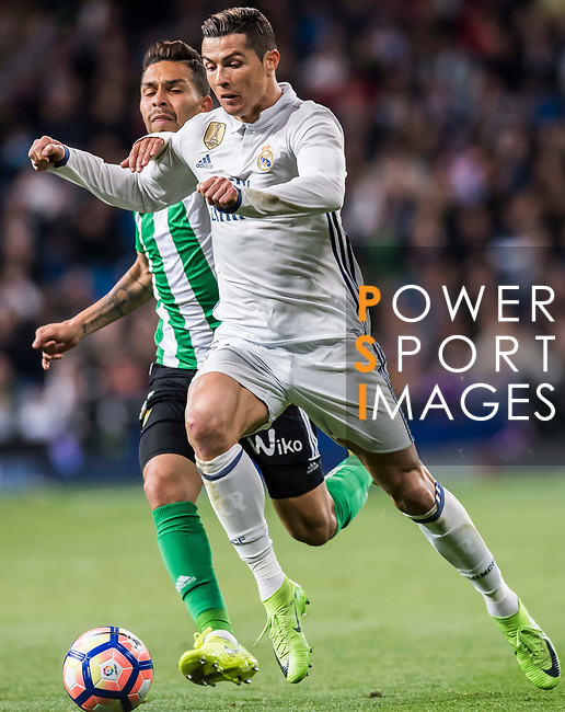 Cristiano Ronaldo (r) of Real Madrid is challenged by Petros Matheus dos Santos Araujo of Real Betis during their La Liga match between Real Madrid and Real Betis at the Santiago Bernabeu Stadium on 12 March 2017 in Madrid, Spain. Photo by Diego Gonzalez Souto / Power Sport Images