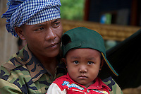 A Khmer man and his son Tonle Sap lake Cambodia