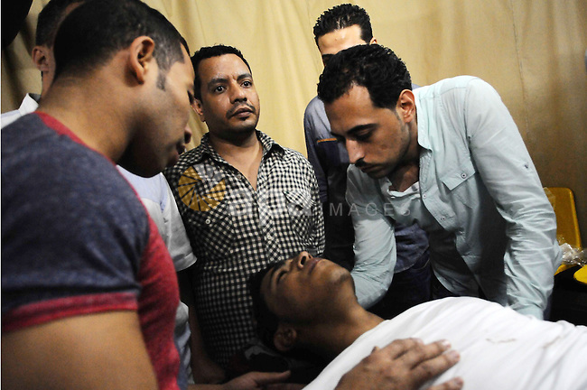 An injured man arrives at the hospital near the site of a blast that wounded 12 people in Cairo, Egypt, Oct. 14, 2014. At least 12 people were injured in the explosion in downtown Cairo late Tuesday, al-Ahram's Arabic website reported on Tuesday. Photo by Amr Sayed